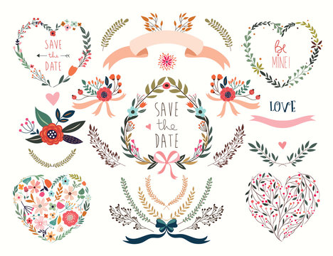 Hand drawn wedding floral hearts with laurels and flowers bouquets