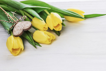 Vanlentine's day concept. Yellow tulips and heart