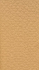 Detailed texture of light brown thick corrugated cardboard