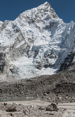 A group of tourists on the trek at the foot of Mt. Everest (8848 m) near Gorak Shep lodge - Nepal, Himalayas