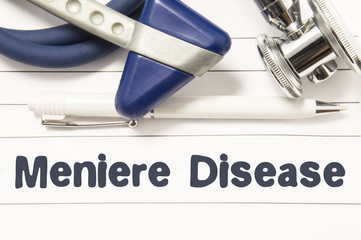 Diagnosis of Meniere Disease closeup. Medical book guide for doctor neurologist with heading text of inner ear disorder Meniere Disease surrounded neurological hammer and stethoscope
