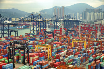 Wall Murals China HONG KONG -MAY13: Containers at Hong Kong commercial port on May 03, 2013 in Hong Kong, China. Hong Kong is one of several hub ports serving more than 240 million tonnes of cargo during the year.