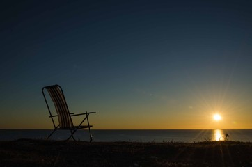 Chair by the setting sun