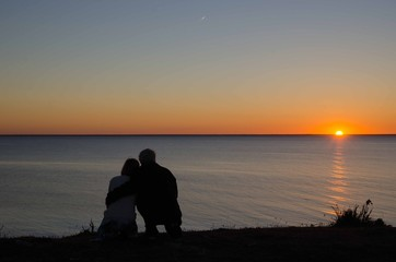 Couple by a romantic sunset