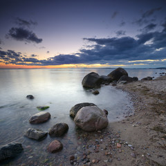 Coastal Sunset, Huge Boulders on Sand Beach, Rugen Island, Germany