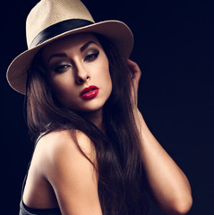 Beautiful sexy female model holding the hand cowboy summer hat a