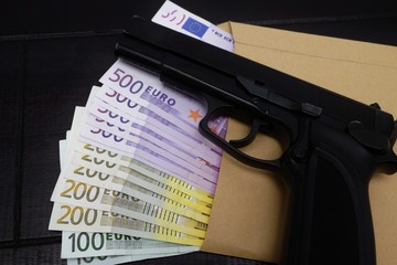 Pistol on euro banknotes