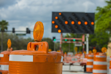 Road closed signs detour traffic temporary street work orange lighted arrow and barrels