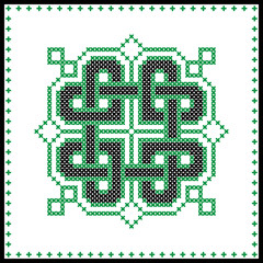 Celtic  knot in black and green cross stitch pattern on white and black background inspired by Irish St Patrick's day and ancient Scottish culture