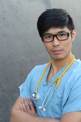 Doctor with stethoscope portrait isolated with arms crossed