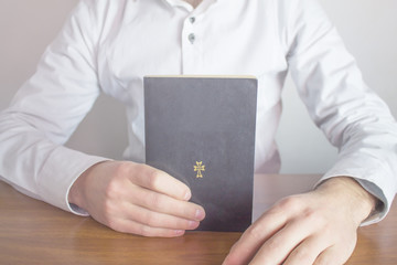 Bible on businessman hand