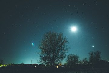 Winter starry sky in the village