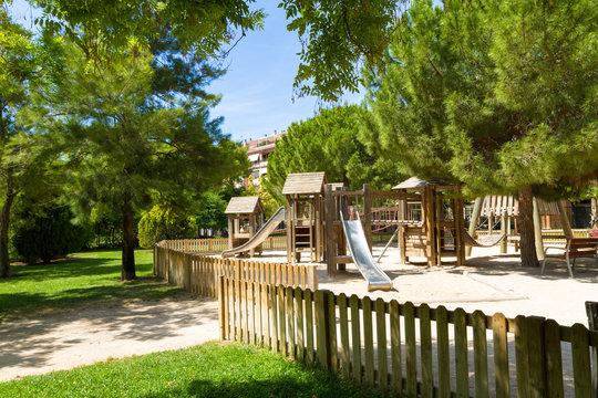Children's wooden playground recreation area at public park
