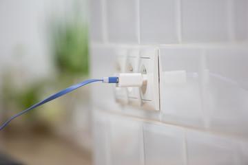 power plug into  power socket, charging