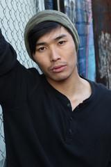 Hip Asian man wearing a beanie