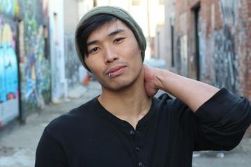 Asian man rocking a beanie outdoors