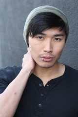 Asian man with piercing and beanie