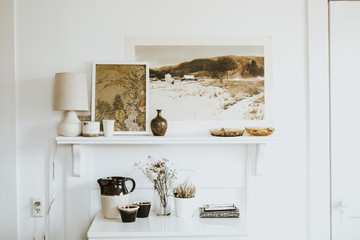 Fireplace with pictures and ornaments