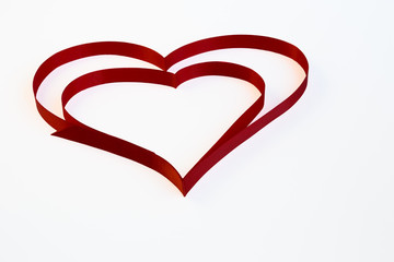 isolated heart of red ribbon on a white background for the  Vale