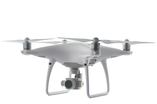 Flying drone quadcopter isolated on white with clipping path