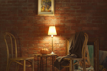 Modern room interior with chairs on brick wall background