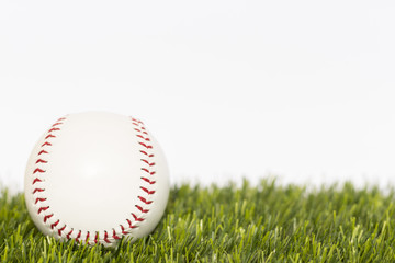 Baseball ball lays on a grass