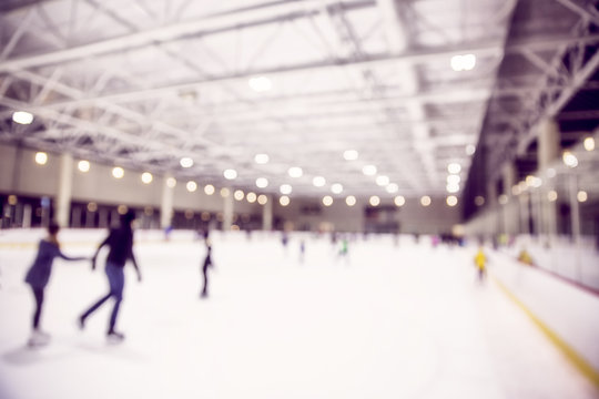 ice skating indoor rink. defocused skating rink with people. blurred background due to the concept. empty space for your text