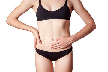 Closeup view of a young woman with stomach pain or digestion or period cycle . isolated on white background.
