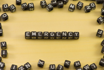 The word emergency on wood background
