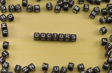 According to the doctors on a wooden background