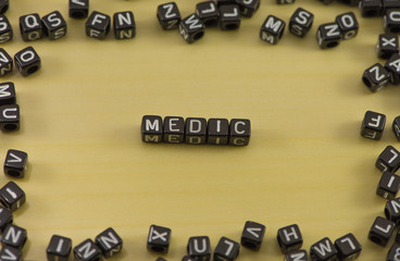 Word medic on a wooden background