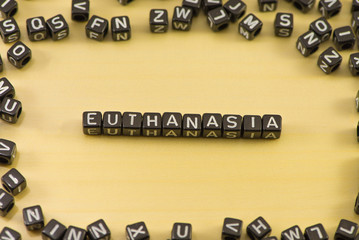 The word euthanasia on wood background