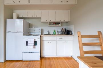 Modern cozy and bright white kitchen. Interior design.