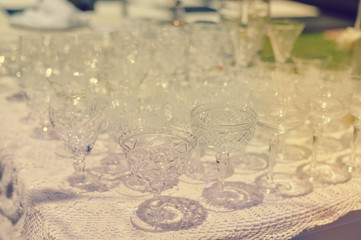 Closeup image of empty glasses for festive event on light background
