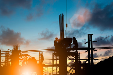 Silhouette engineer standing orders for construction crews