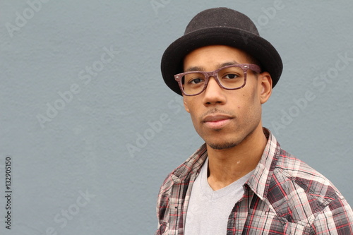 Man with Fedora hat and eye glasses