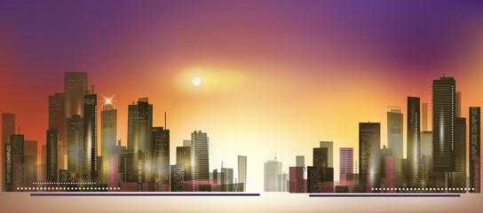 Modern night city skyline at sunset