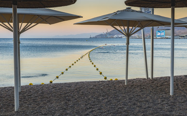 Morning at central public beach of Eilat - number one resort and recreational city in Israel located on the Red Sea