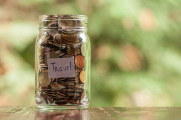 Jar of full coins in concept money saving