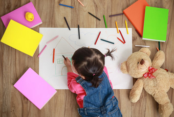 Adorable little girl drawing artwork. Studio shot top view of ch