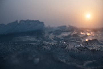 Small ice crystals on frozen sea. Selective focus and shallow depth of field.