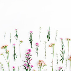 Colorful wildflowers on white background. Flat lay, top view. Valentine's background