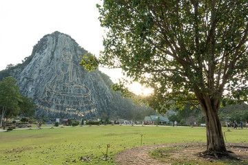 Carved buddha image from gold on the cliff at Khao Chee chan