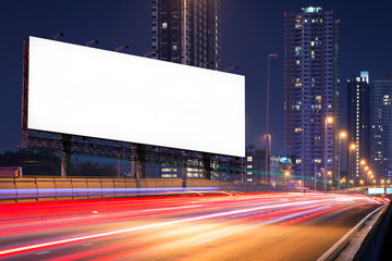 left view of Blank billboard on light trails, street and urban in the night - can advertisement for display or montage product or business.