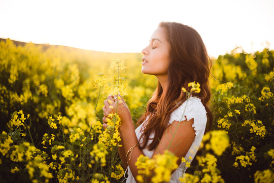 Young girl in yellow flower field