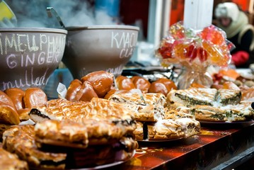 Christmas market stalls with hot mulled wine, baked goods