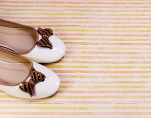 female flat ballet shoes on colorful background