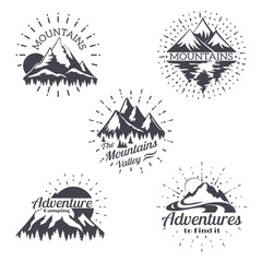 Mountain sketch vector logo set in retro style. Vintage trendy lines mountains silhouettes labels