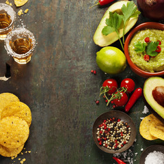Bowl of guacamole with fresh ingredients and tequila shots