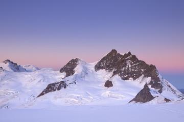 Wall Mural - Dawn at the Jungfrau peak from Jungfraujoch in Switzerland